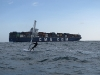 container ship while crossing the channel on windsurfer