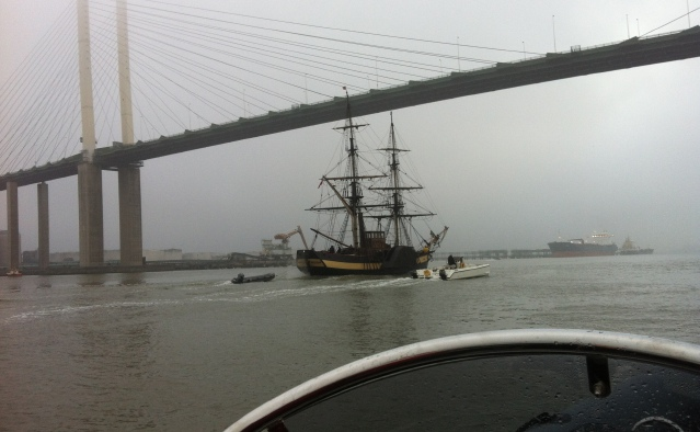 Tall Ship under Dartford bridge on Thames with rib